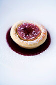 A tartlet-shaped foam omelette with figs and fig jus