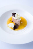 chocolate parfait on orange sauce with piment d'espelette