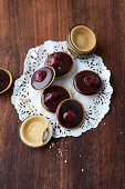 Mini chocolate tartlets with sour cherries