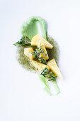 Pineapple with rosemary jus, avocado and thyme tempura