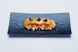 Blue lobster mille feuille with sugar melon, mint and salmon caviar