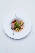 Saddle of milk-fed lamb with a salted almond crust, gorgonzola and rosemary pasta and a tamarind and mustard sauce