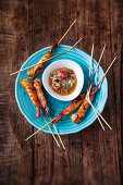 Grilled king prawn skewers with a sweet and spicy tomato dip