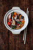 Mussels in a clear tomato broth with Thai basil