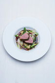 Wagyu beef medallions on poached asparagus