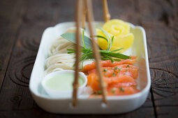 Salmon and noodles with a radish rose and wasabi (Japan)