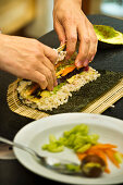 Vegan nori maki being made