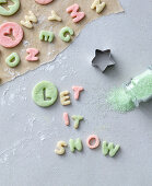 The words 'Let it snow' cut out of colourful pastry