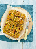 Frittata with yoghurt, carrots, pumpkin flowers, pistachio nuts and almonds
