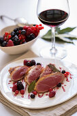 Fried duck breast with a red wine and berry sauce