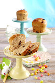 Mini Easter buns with sultanas on coloured cake stands