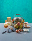 An arrangement of cheese, sausage, vegetables, fruit and cake from Lombardy, Italy