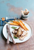 Marinated roast veal with carrots and and creamy sauce