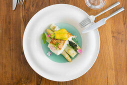 White asparagus with fish and a stuffed courgette flower