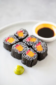 Vegan maki sushi with black rice, sweet potato and pink ginger