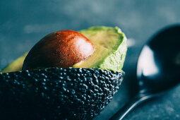 Sliced avocado on dark background