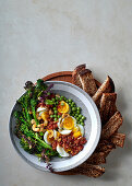 Egg salad with sun-dried tomato-and-cashew nut pesto and broccolini