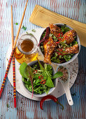 Chicken with black and white sesame seeds (Asia)