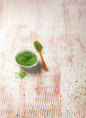 Green wasabi sesame seeds in a bowl and on a spoon