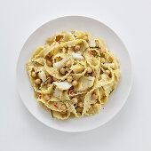 Reginette pasta with stock fish, chickpeas and pecorino