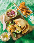 Stuffed pita bread with roast chicken, pickled vegetables and hummus