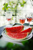 Watermelon slices and rosé wine