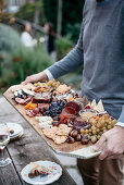 South Tyrol ham and cheese plate with various confits and fruit
