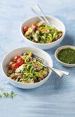 Courgetti with blistered tomatoes, squid, chorizo and salsa verde