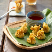 Coconut wontons on a banana leaf