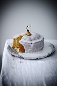 A vanilla and pear cake with icing