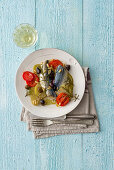 Mackerel rolls with potatoes, tomatoes, garlic and pine nuts