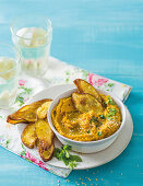 Pumpkin hummus with baked cumin-spiced sweet potato chips