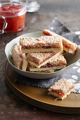 Coconut slices with melon and redcurrant jam and cardamom