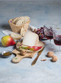 Tomme de chevre with pears and grapes