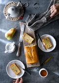 Freshly baked pear cake with tea on rustic table