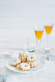 Canestrelli (almond cookies for Christmas, Italy), served with Malvasia liqueur