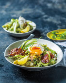 Green saparagus and ricotta penne with poached egg, ricotta and bacon
