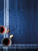 Red wine glasses on a blue tablecloth