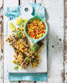 Fish kebabs with corn salad