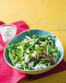 Green salad with peas, beans and feta