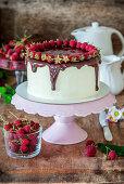 Chocolate and vanilla buttercream cake with raspberries