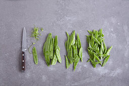 Mange tout being cleaned and diagonally sliced