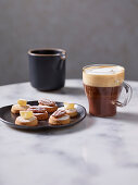 Shortbreads with pecan nuts and candied ginger and hot chocolate with espresso and cream