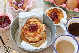 A stack of gluten-free buckwheat pancake made from quark dough with raspberry jam for an Easter breakfast