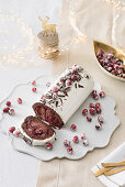 A festive chocolate and cranberry roulade