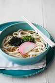 Udon noodle soup with radishes and algae (Japan)