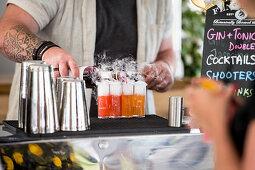 A bartender preparing cocktails