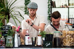 Two bartenders at work