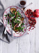 Eggplants with green beans and pomegranate