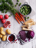 Potatoes, cranberries, red cabbage, parsnips, carotts and pomegranate